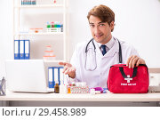 Купить «Young doctor with first aid kit in hospital», фото № 29458989, снято 23 августа 2018 г. (c) Elnur / Фотобанк Лори