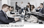 Купить «Confident businessman concentrated on work with laptop in coworking space», фото № 29464597, снято 21 апреля 2018 г. (c) Яков Филимонов / Фотобанк Лори