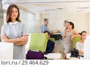 Купить «Unhappy tired young business woman standing in busy open plan office», фото № 29464629, снято 1 августа 2018 г. (c) Яков Филимонов / Фотобанк Лори