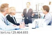 Купить «Businesswoman explaining to workgroup plans», фото № 29464693, снято 1 июля 2017 г. (c) Яков Филимонов / Фотобанк Лори