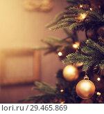 Купить «decorations on a Christmas tree and glare of lights», фото № 29465869, снято 4 ноября 2017 г. (c) katalinks / Фотобанк Лори