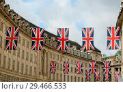 Купить «Regents Street in the heart of London's West End is decorated with Union Jack flags as London prepares to celebrate the wedding of Prince Harry and Meghan...», фото № 29466533, снято 2 мая 2018 г. (c) age Fotostock / Фотобанк Лори