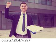Купить «Smiling manager is happy after successful signing contract», фото № 29474997, снято 3 июня 2017 г. (c) Яков Филимонов / Фотобанк Лори