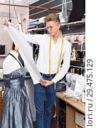 Купить «Dressmaker at work – creating dress style», фото № 29475129, снято 20 октября 2018 г. (c) Яков Филимонов / Фотобанк Лори