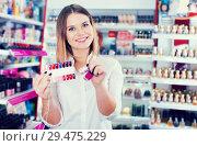 Купить «salesgirl showing palette of nail polish colors», фото № 29475229, снято 31 января 2018 г. (c) Яков Филимонов / Фотобанк Лори