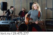 Купить «excited girl rock singer with guitar during rehearsal», фото № 29475277, снято 26 октября 2018 г. (c) Яков Филимонов / Фотобанк Лори