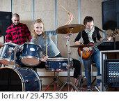 Купить «Music band with smiling girl drummer rehearsing», фото № 29475305, снято 26 октября 2018 г. (c) Яков Филимонов / Фотобанк Лори