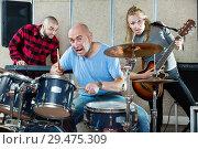 Купить «Rehearsal of music group with male drummer», фото № 29475309, снято 26 октября 2018 г. (c) Яков Филимонов / Фотобанк Лори