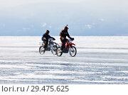 Купить «Baikal Lake. Two sports girls travels by motorcycles on the ice of the frozen Small Sea Strait», фото № 29475625, снято 8 марта 2015 г. (c) Виктория Катьянова / Фотобанк Лори