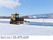 Купить «Lake Baikal in winter. Road services clear snow from the ice road to Olkhon Island», фото № 29475629, снято 26 февраля 2017 г. (c) Виктория Катьянова / Фотобанк Лори