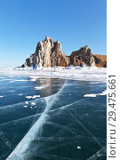 Купить «Lake Baikal in the winter. Olkhon Island. View of the natural landmark - the Shamanka Rock from the ice on a sunny day», фото № 29475661, снято 22 февраля 2015 г. (c) Виктория Катьянова / Фотобанк Лори