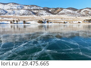 Купить «Baikal Lake in the winter sunny day. Coast of the Small Sea Strait (Maloe More) and smooth blue ice with cracks. Beautiful winter landscape», фото № 29475665, снято 22 февраля 2015 г. (c) Виктория Катьянова / Фотобанк Лори