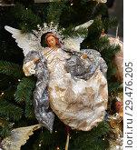 Купить «Christmas and New Year. Angel with violin in background of Christmas tree», фото № 29476205, снято 25 ноября 2018 г. (c) Валерия Попова / Фотобанк Лори