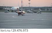 Купить «Official spotting. The plane Rusline airlines performs taxiing at the airport.», видеоролик № 29476973, снято 1 августа 2018 г. (c) Андрей Радченко / Фотобанк Лори
