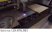 Купить «Automatic CNC plasma cutting machine cuts details from steel sheet», видеоролик № 29476981, снято 26 октября 2018 г. (c) Андрей Радченко / Фотобанк Лори