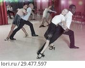 Купить «Adult couples dancing active dance together in modern studio», фото № 29477597, снято 4 октября 2018 г. (c) Яков Филимонов / Фотобанк Лори