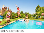 Купить «Group of friends jumping in outdoor swimming pool», фото № 29478185, снято 21 июля 2018 г. (c) Сергей Новиков / Фотобанк Лори