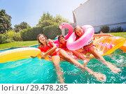 Купить «Cute children enjoying summertime in outdoor pool», фото № 29478285, снято 21 июля 2018 г. (c) Сергей Новиков / Фотобанк Лори