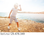 Купить «Happy teenage boy dancing on the beach in summer», фото № 29478349, снято 22 июля 2018 г. (c) Сергей Новиков / Фотобанк Лори