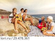 Купить «Friends playing musical instruments on the beach», фото № 29478361, снято 22 июля 2018 г. (c) Сергей Новиков / Фотобанк Лори