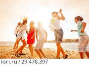 Купить «Happy teenagers having fun during beach party», фото № 29478397, снято 22 июля 2018 г. (c) Сергей Новиков / Фотобанк Лори