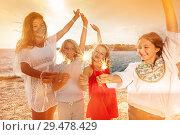 Купить «Teens having fun using sparklers on beach party», фото № 29478429, снято 22 июля 2018 г. (c) Сергей Новиков / Фотобанк Лори