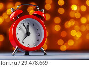 Купить «Red alarm clock on blurry lights background. Before the new year 5 minutes.», фото № 29478669, снято 23 ноября 2018 г. (c) Александр Якимов / Фотобанк Лори