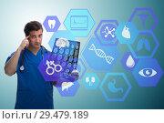 Купить «Doctor looking at x-ray image in telehealth concept», фото № 29479189, снято 26 марта 2019 г. (c) Elnur / Фотобанк Лори