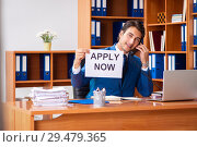 Купить «Young employee working in the office», фото № 29479365, снято 9 августа 2018 г. (c) Elnur / Фотобанк Лори
