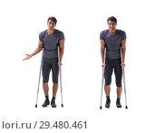 Купить «Young patient athlete sportsman suffering an injury trauma with», фото № 29480461, снято 28 июля 2017 г. (c) Elnur / Фотобанк Лори