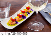 Купить «Ceviche of pickled salmon on kiwi with figs, cumquat», фото № 29480685, снято 21 октября 2019 г. (c) Яков Филимонов / Фотобанк Лори