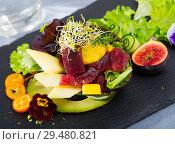 Купить «Image of delicious salad of raw tuna, mango, avocado and herbs», фото № 29480821, снято 19 декабря 2018 г. (c) Яков Филимонов / Фотобанк Лори