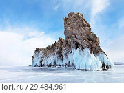 Купить «Baikal Lake. Beautiful Ogoy Island with blue ice crust and icicles on coastal rocks on a winter sunny day. Cape Dragon - a natural landmark and a place of tourist excursions», фото № 29484961, снято 1 марта 2015 г. (c) Виктория Катьянова / Фотобанк Лори