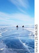 Купить «Two extreme tourists on bikes cross Lake Baikal on a frosty February day. Winter activities and travel», фото № 29484965, снято 8 марта 2015 г. (c) Виктория Катьянова / Фотобанк Лори