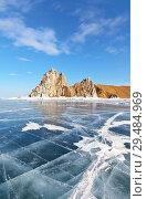 Купить «Lake Baikal in March. The natural landmark of the island of Olkhon is the Shamanka Rock on a sunny day. Cracks in the blue ice», фото № 29484969, снято 8 марта 2015 г. (c) Виктория Катьянова / Фотобанк Лори