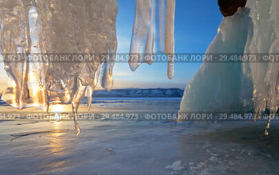 Купить «Lake Baikal. View from the ice grotto in the cliff of Olkhon Island on the Small Sea Strait at sunset. Beautiful winter landscape», фото № 29484973, снято 8 марта 2015 г. (c) Виктория Катьянова / Фотобанк Лори