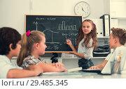 Купить «Girl discussing about mathematical formulas», фото № 29485345, снято 12 октября 2017 г. (c) Яков Филимонов / Фотобанк Лори