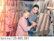 Купить «Positive female teacher assisting student during painting», фото № 29485381, снято 21 августа 2019 г. (c) Яков Филимонов / Фотобанк Лори