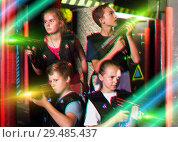 Купить «Girls and boys posing with laser pistols», фото № 29485437, снято 17 января 2019 г. (c) Яков Филимонов / Фотобанк Лори