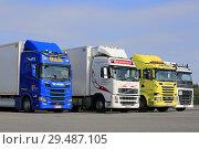 Купить «Hirvaskangas, Finland - August 24, 2018: Colorful Scania and Volvo freight transport trucks on asphalt yard of a truck stop on a day of summer.», фото № 29487105, снято 24 августа 2018 г. (c) age Fotostock / Фотобанк Лори