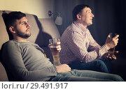 Купить «Indifferent gu with friend emotionally watching tv», фото № 29491917, снято 7 февраля 2018 г. (c) Яков Филимонов / Фотобанк Лори