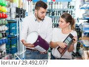 Купить «Couple choosing paint in household store», фото № 29492077, снято 17 мая 2018 г. (c) Яков Филимонов / Фотобанк Лори