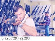 Купить «Man choice pneumatic gun», фото № 29492293, снято 4 июля 2017 г. (c) Яков Филимонов / Фотобанк Лори