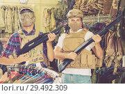 Купить «Male customers try on ammunition with weapon», фото № 29492309, снято 4 июля 2017 г. (c) Яков Филимонов / Фотобанк Лори