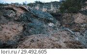 Купить «A small trickles streams on the rocky wall», видеоролик № 29492605, снято 24 апреля 2019 г. (c) Константин Шишкин / Фотобанк Лори