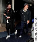 Adam DeVine and girlfriend Chloe Bridges arrive at Los Angeles International... (2018 год). Редакционное фото, фотограф WENN.com / age Fotostock / Фотобанк Лори