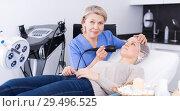 Купить «Cosmetician performing hardware face treatment», фото № 29496525, снято 16 марта 2018 г. (c) Яков Филимонов / Фотобанк Лори