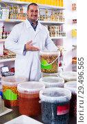 Купить «Shop staff standing near containers with olives in flavoured brine», фото № 29496565, снято 15 октября 2016 г. (c) Яков Филимонов / Фотобанк Лори