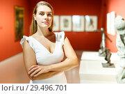 Купить «Woman observing museum exposition», фото № 29496701, снято 28 июля 2018 г. (c) Яков Филимонов / Фотобанк Лори