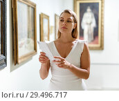Woman visiting painting exhibition. Стоковое фото, фотограф Яков Филимонов / Фотобанк Лори